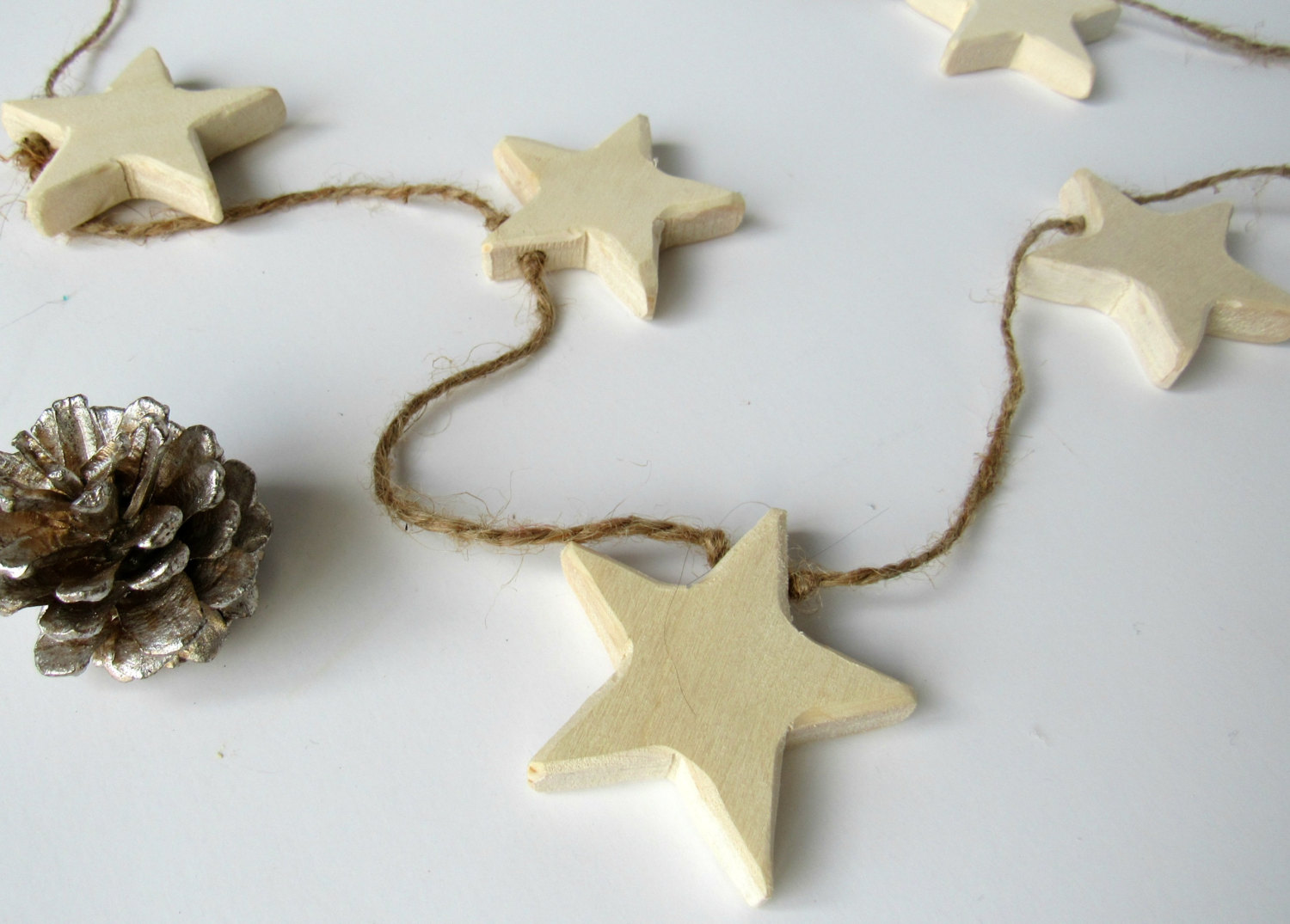 Michigan Gift Idea: Handmade Home Decor From Wood By Al // Featured - Wooden Star Twine Garland (via Wading in Big Shoes)