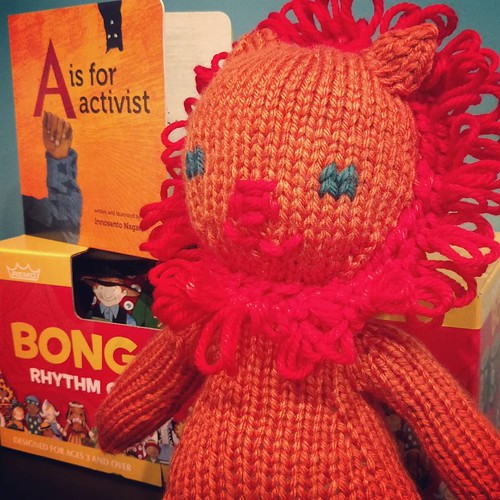 20161013. Christmas gift stockpile has begun: bong(o) drums, a hand-knitted lion, and maybe the coolest board book I've ever seen. 211/365. #365days