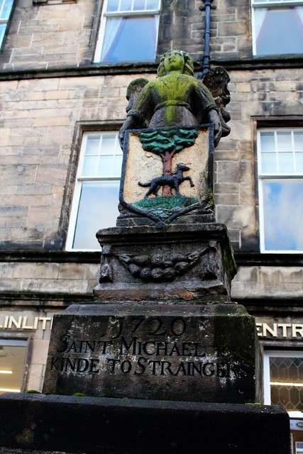 18th century plaque commemorating St Michael who is closely associated with Linlithgow.
