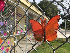 Monarch butterfly artwork by students of Bernice Curren School, honoring loved ones lost on Dia de los Muertos