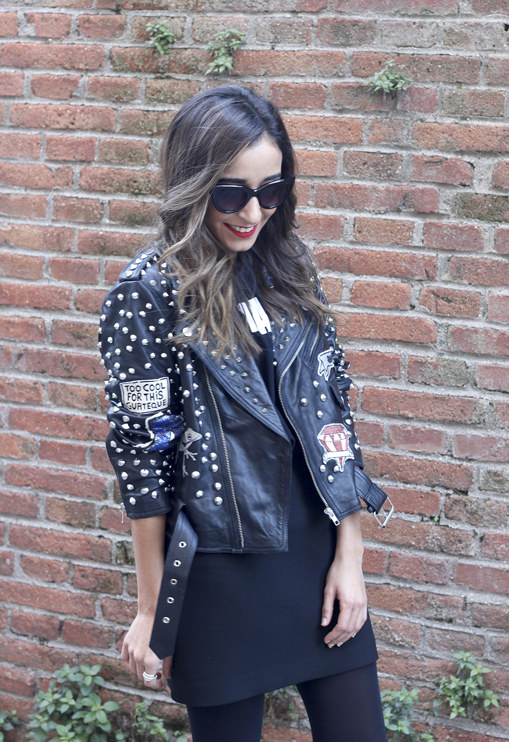Leather jacket with studs and patches black skirt heels style fashion outfit10
