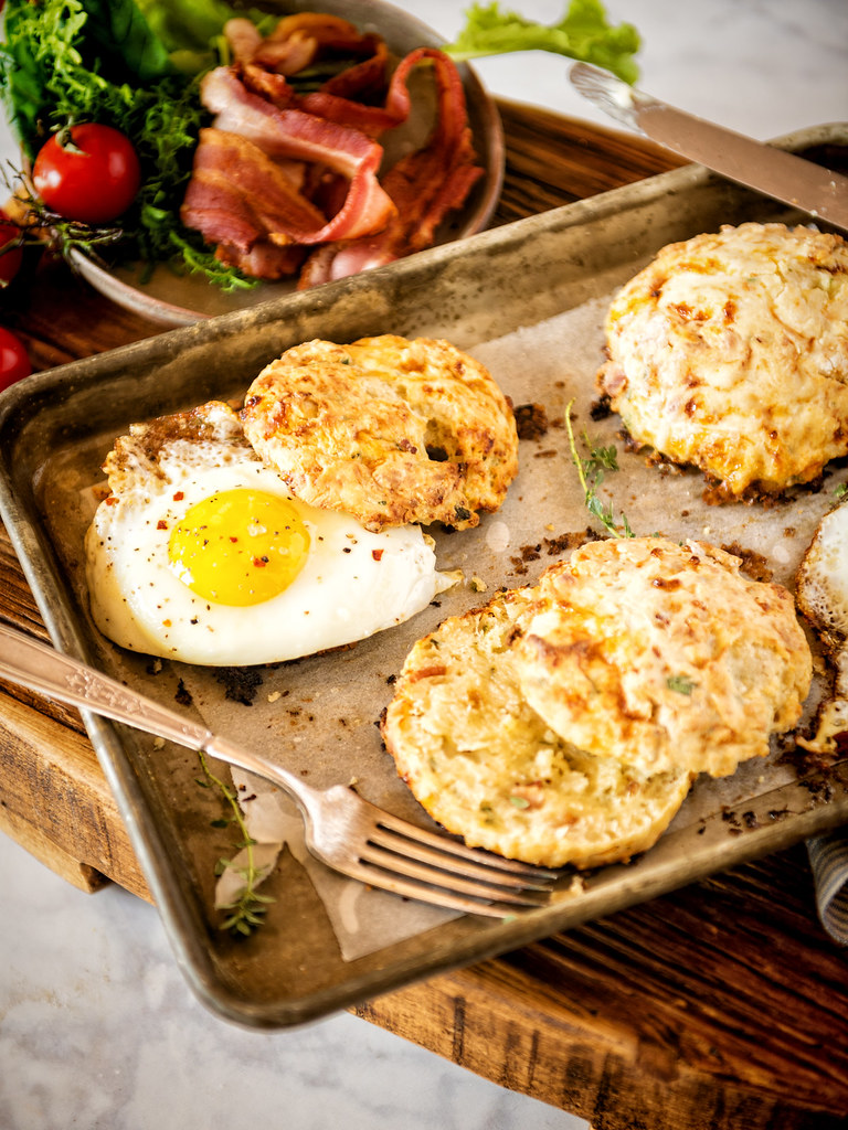 These fast and easy Herb and Bacon Cottage Cheese Biscuits are the perfect by themselves or with an fried egg! | Recipe at GirlCarnivore.com