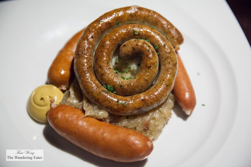Sausage platter - Thuringer sausage, Cheese sausage, Frankfurter sausage, Polish sausage, served with sauerkraut and creamy mashed potato