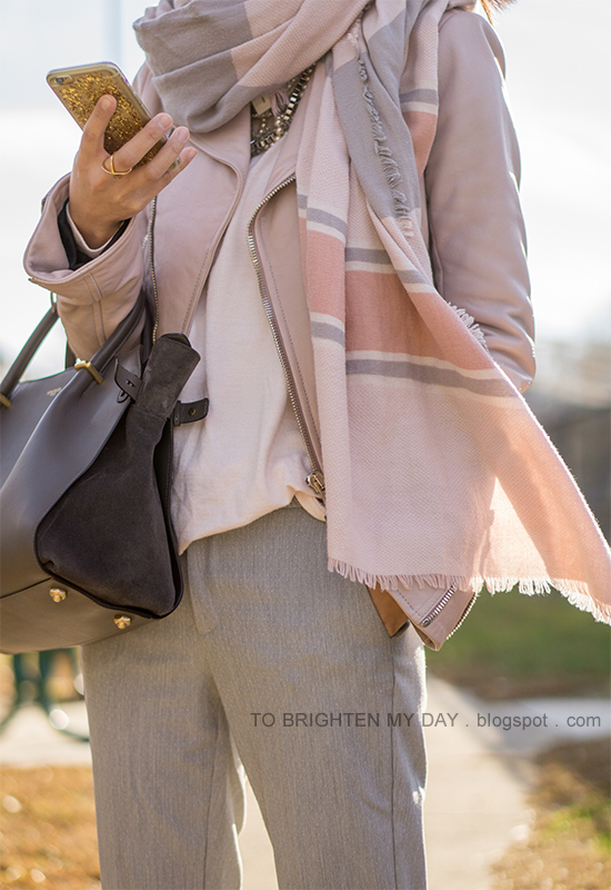 pink striped blanket scarf, lilac pink leather jacket, pale pink sweater, light gray pants, gray tote