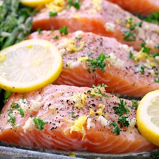Sheet Pan Lemon, Garlic & Herb Salmon with Asparagus close up.