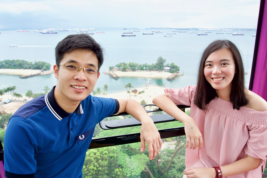 Joshua & Tiffany with Siloso Beach in the background.