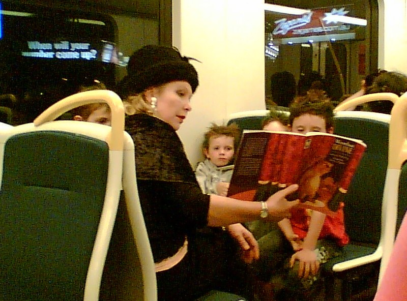 Reading a story on the train, December 2006