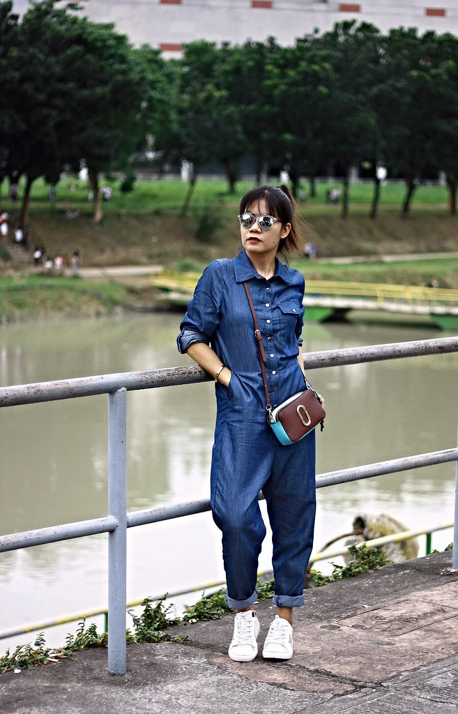 denim, denim jumpsuit, jumpsuit, irisie, crossbody bag, white sneakers