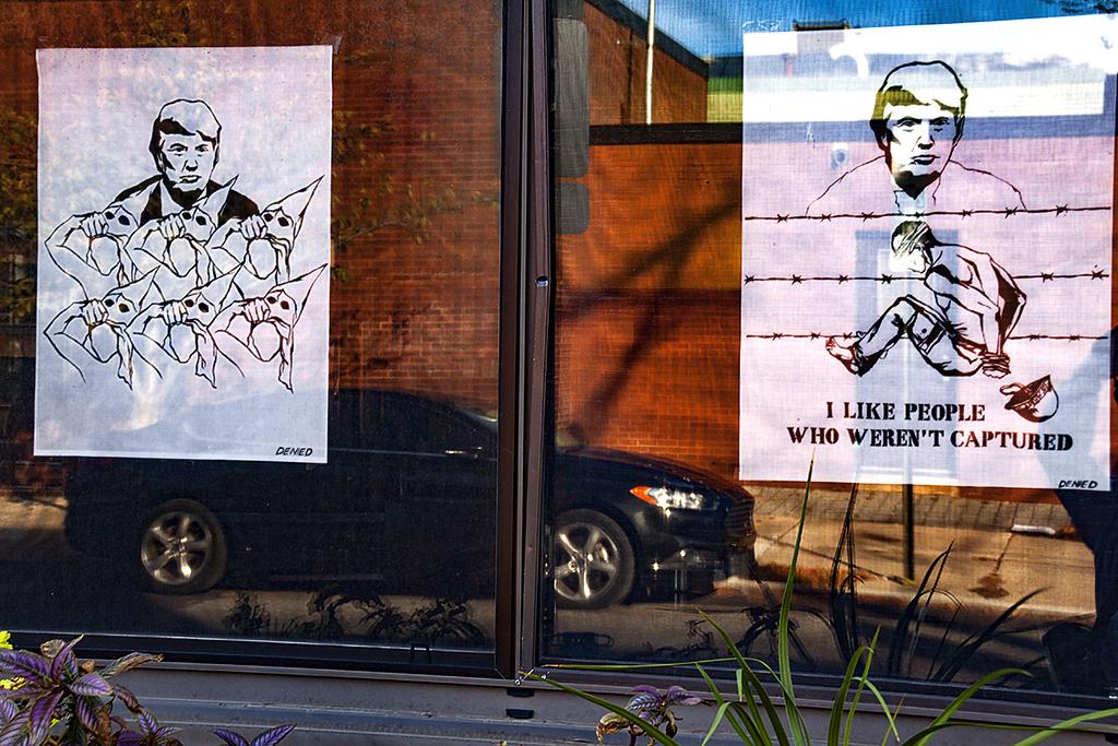 Drawings of Trump in diner window--Bella Vista
