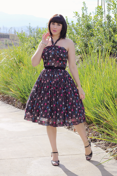 Red Ruby Vintage 1950s Style Halter Neck Full Skirt Sundress in a 1930s Novelty Cotton Gauze Fabric with Balloons and Streamers Print