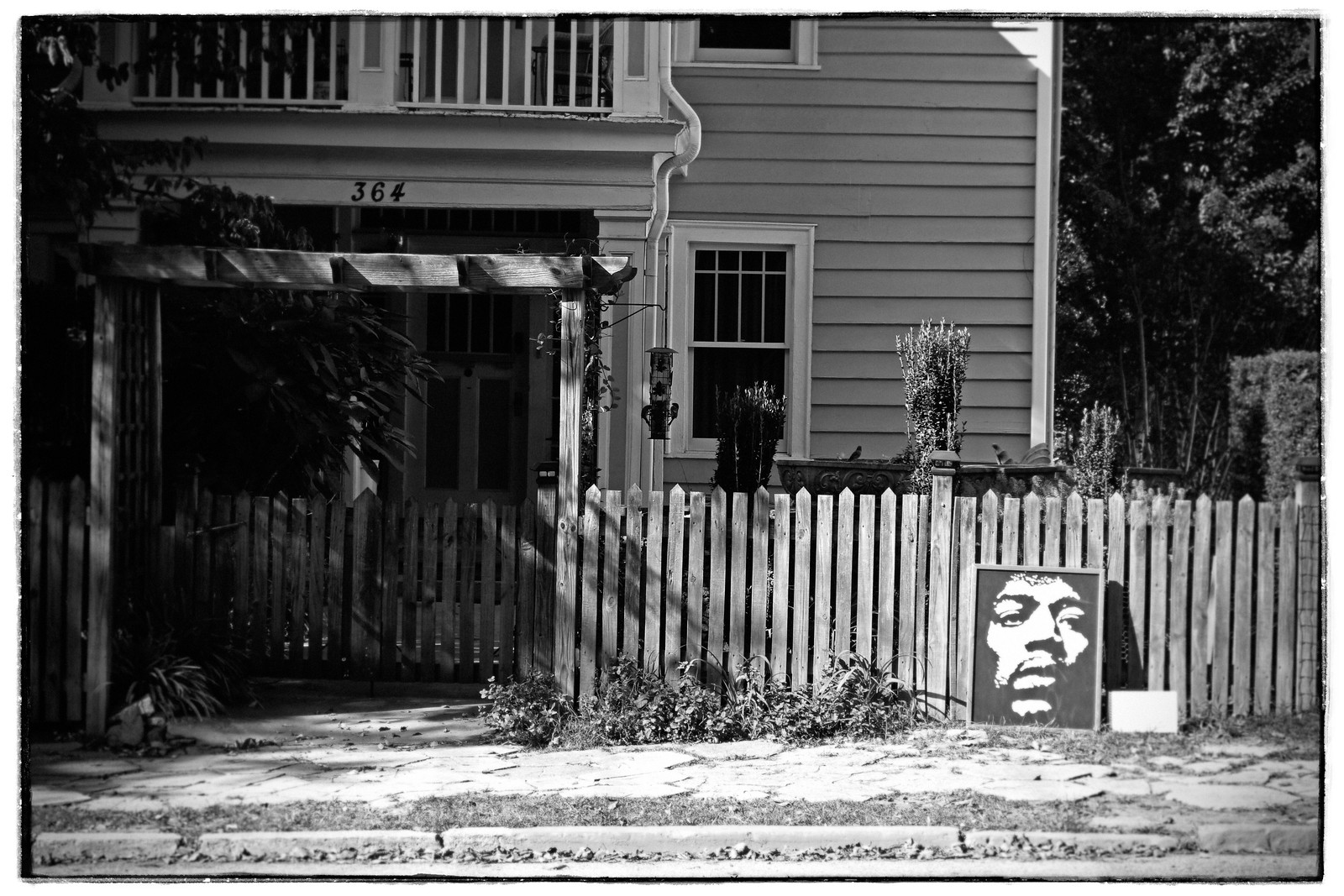 Fence and Print of Jimi Hendrix. Sept 2015