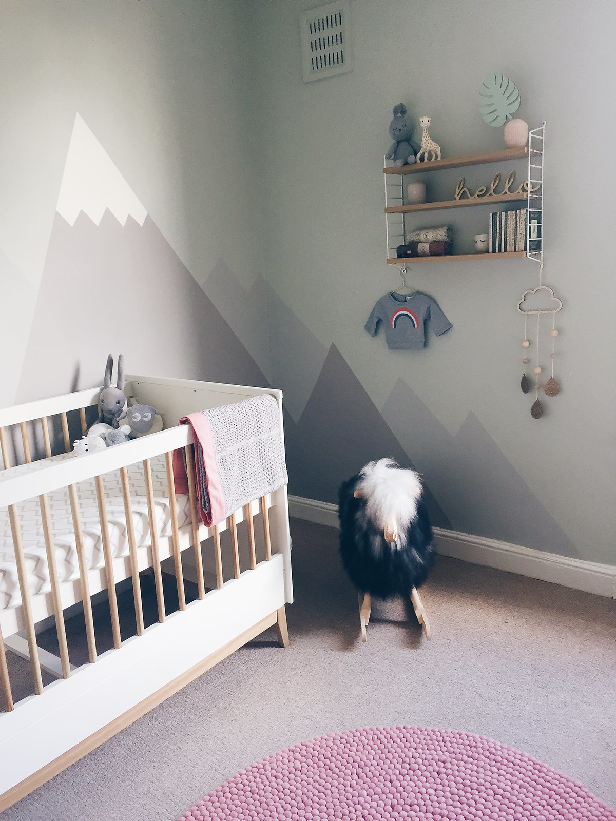 gender neutral mountain mural nursery