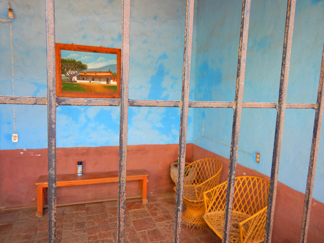 Bright blue interior behind a barred gateway in Talpa, one of Mexico's Pueblos Magicos in the Pacific high sierras