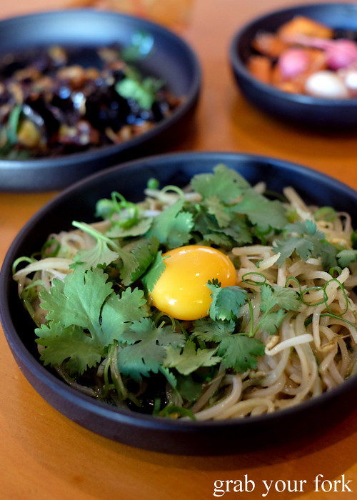 Stir-fried potato, bean sprouts and raw yolk at Good Luck Pinbone in Kingsford