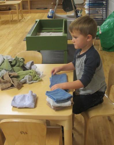 very neatly folding washcloths