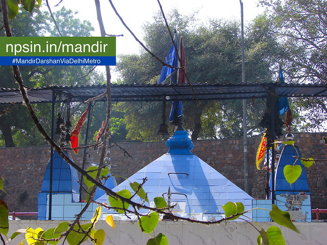 A blue shaded temple Shikhar with Blue roof, close to the banks of the Yamuna river.