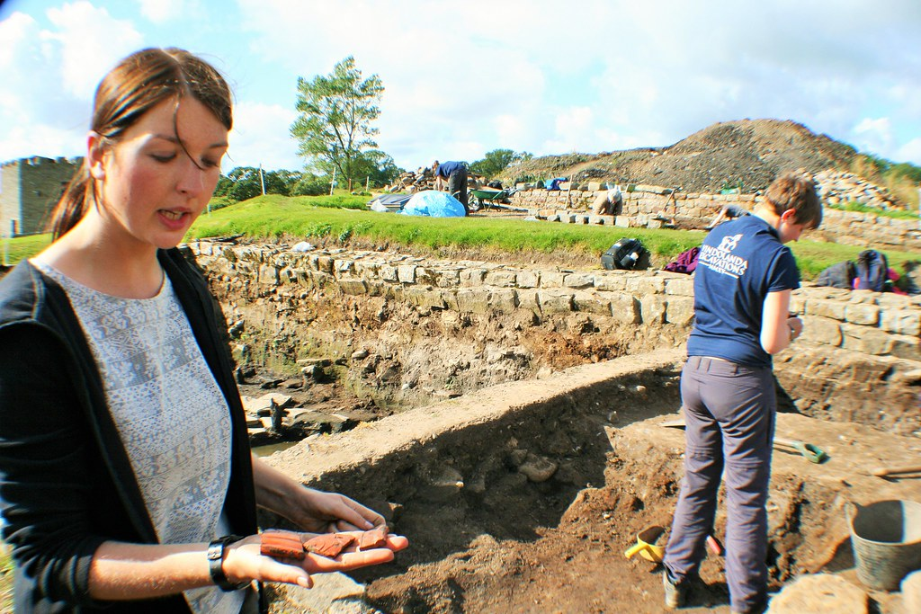 Archaeologist explaining finds at Vindolanda.