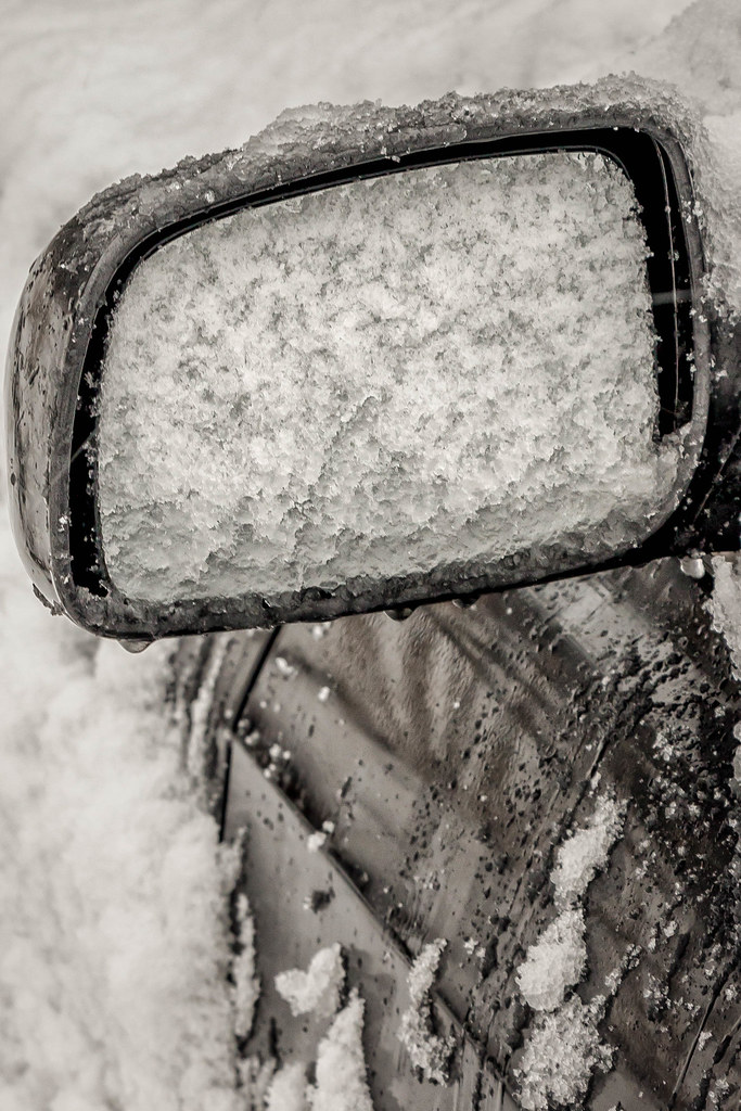 snowy rearview mirror