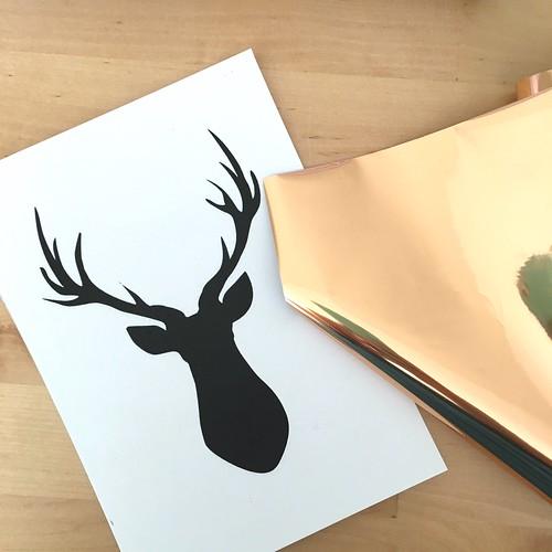 Foiled deer holiday decor