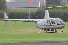 G-DWCE - 2006 build Robinson R44 Raven II, lifting for departure at Barton