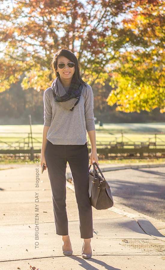 navy/green plaid and herringbone infinity scarf, gray button back sweater, navy pants, gray tote, gray suede pumps