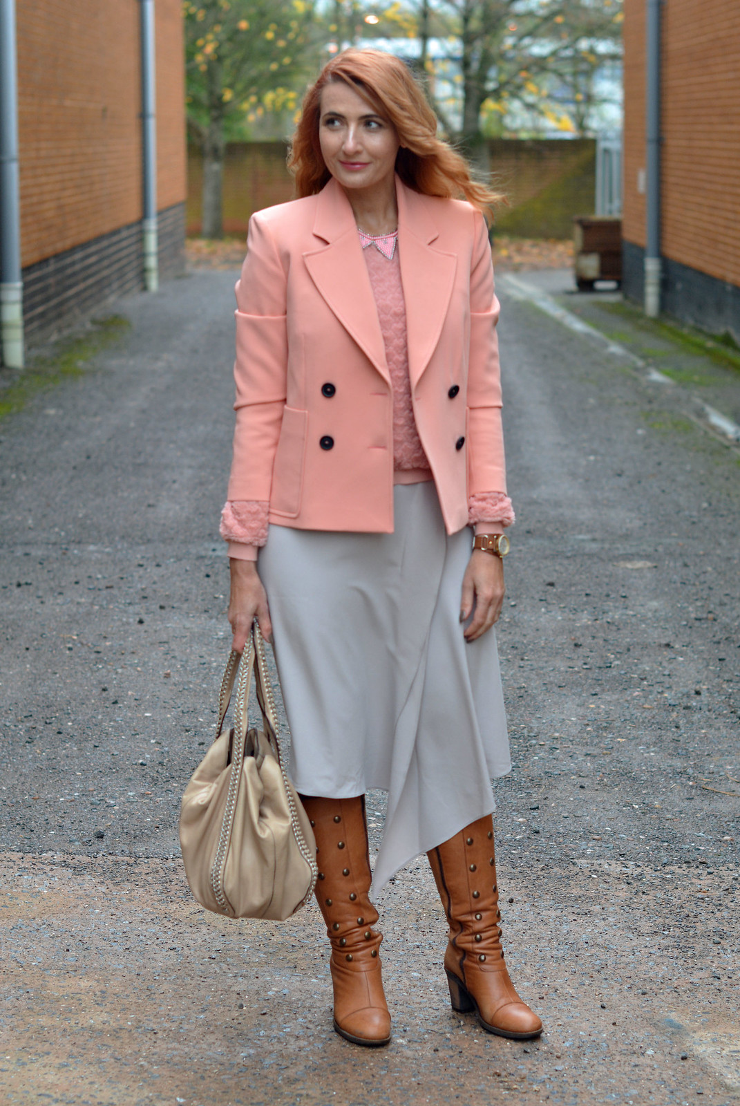Peach tailored jacket, grey midi skirt, tan boots
