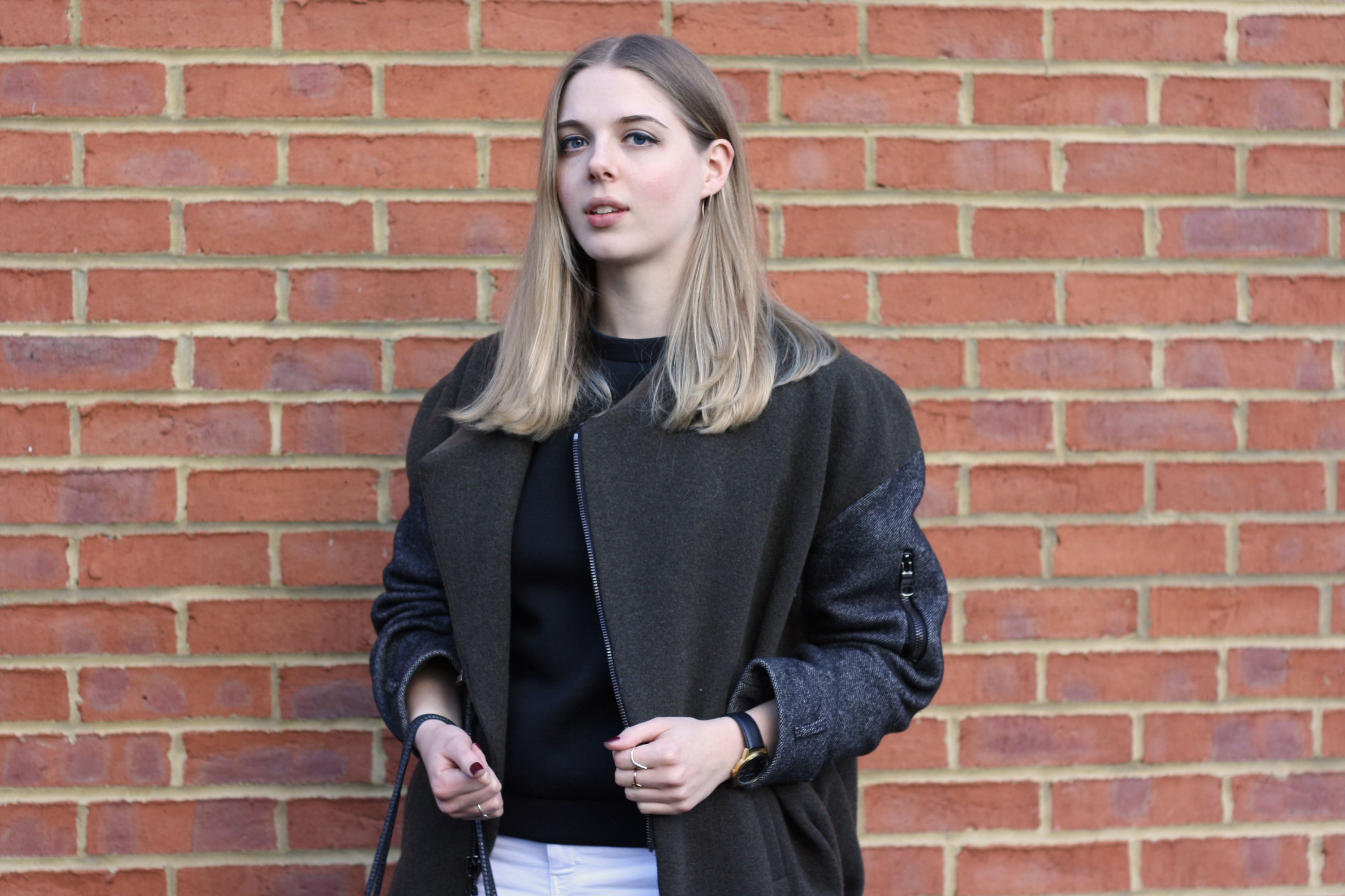 Topshop Unique khaki jacket, ASOS rose gold spike earrings and Larsson Jennings black Saxon watch