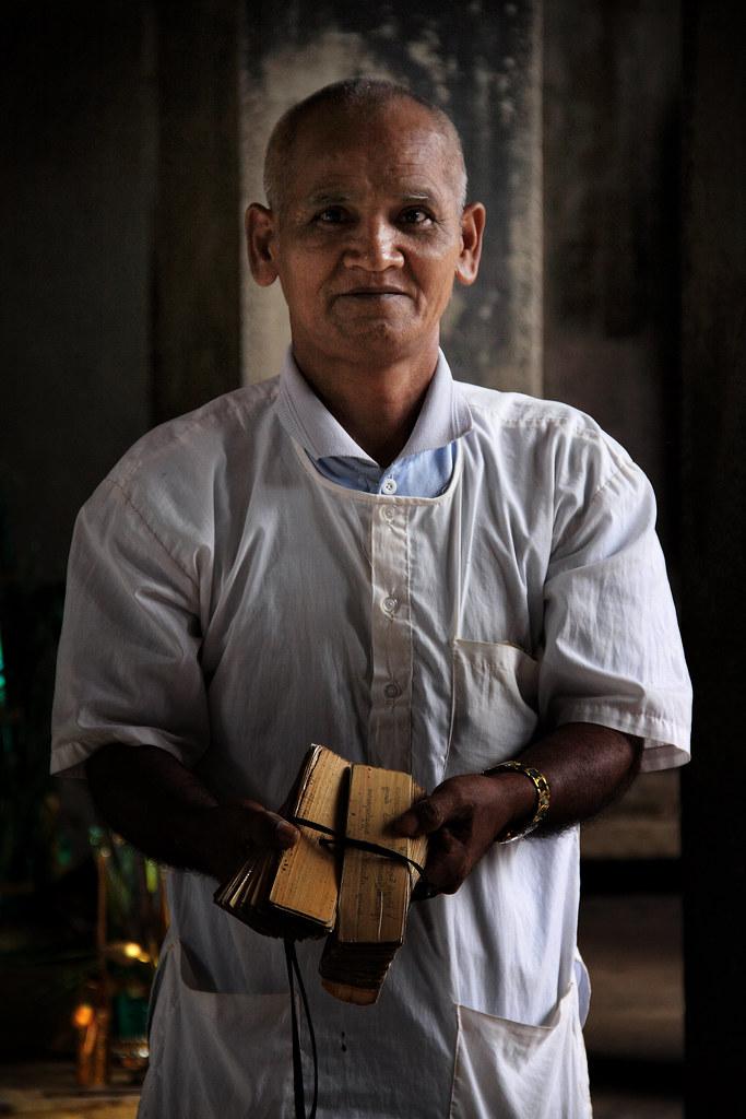 A Cambodian Man Shows Buddhist Pali Texts