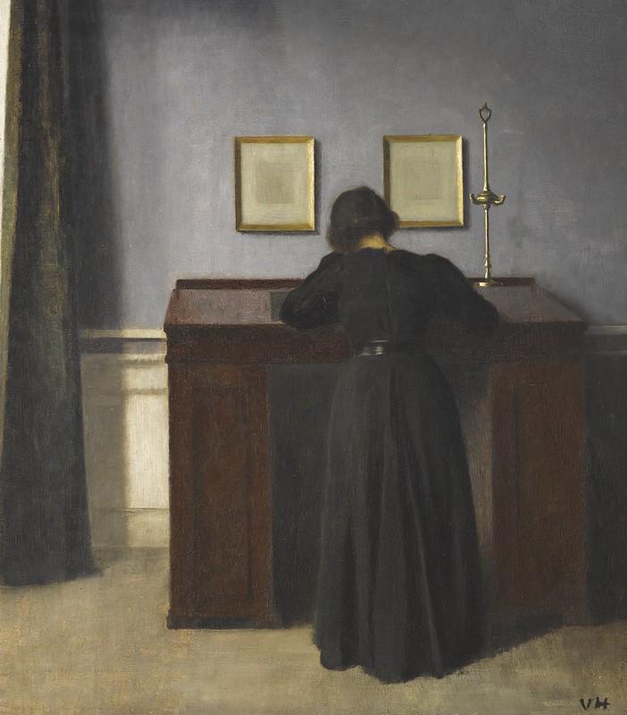 Vilhelm Hammershøi - Ida standing at a desk (1900)