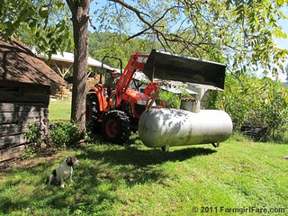 Joe uses the tractor to move the propane tank | by Farmgirl Susan
