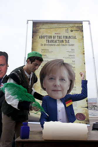 Oxfam activist as Merkel poses with Robin Hood | by Oxfam International
