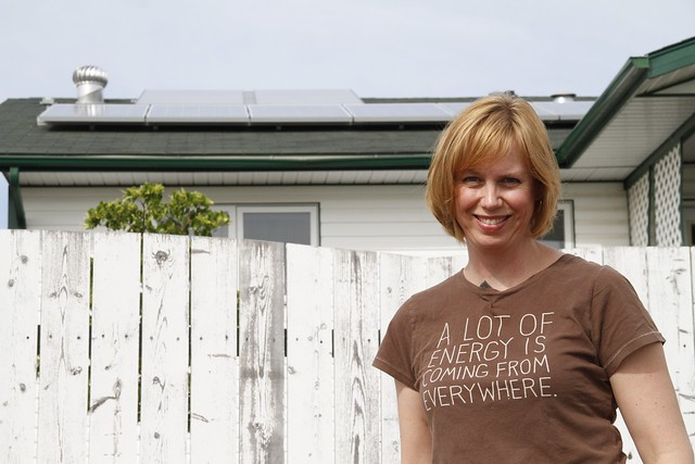 Tina Regehr with solar electric and solar hotwater panels