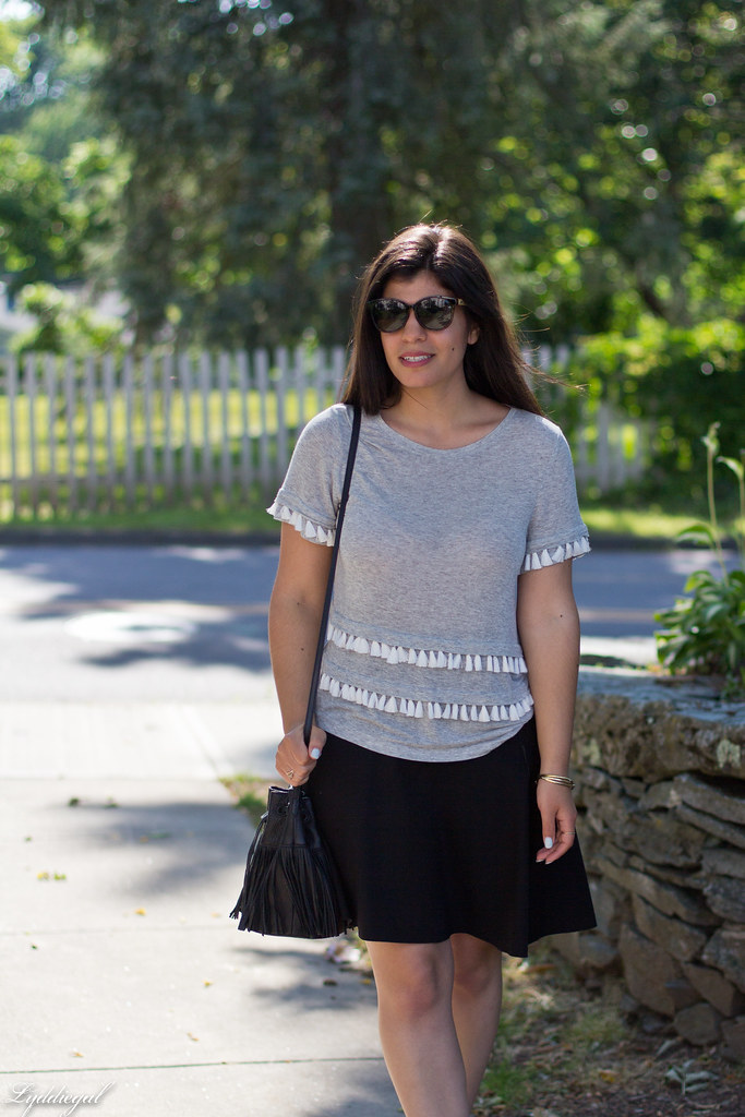tassel tee shirt, black skirt, fringe bag.jpg