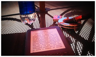 Kindle & cigar, on the back terrace, Friday afternoon. | by arellis49