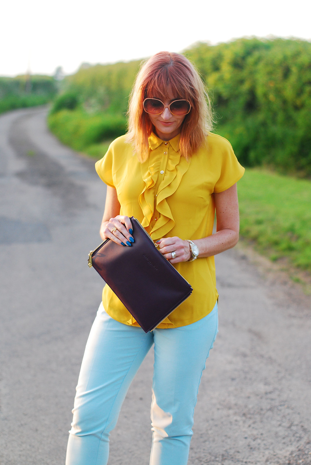 Summer brights: Ruffled yellow blouse, mint trousers, Jennifer Hamley Model KT Workbag clutch, oversized 70s sunglasses | Not Dressed As Lamb
