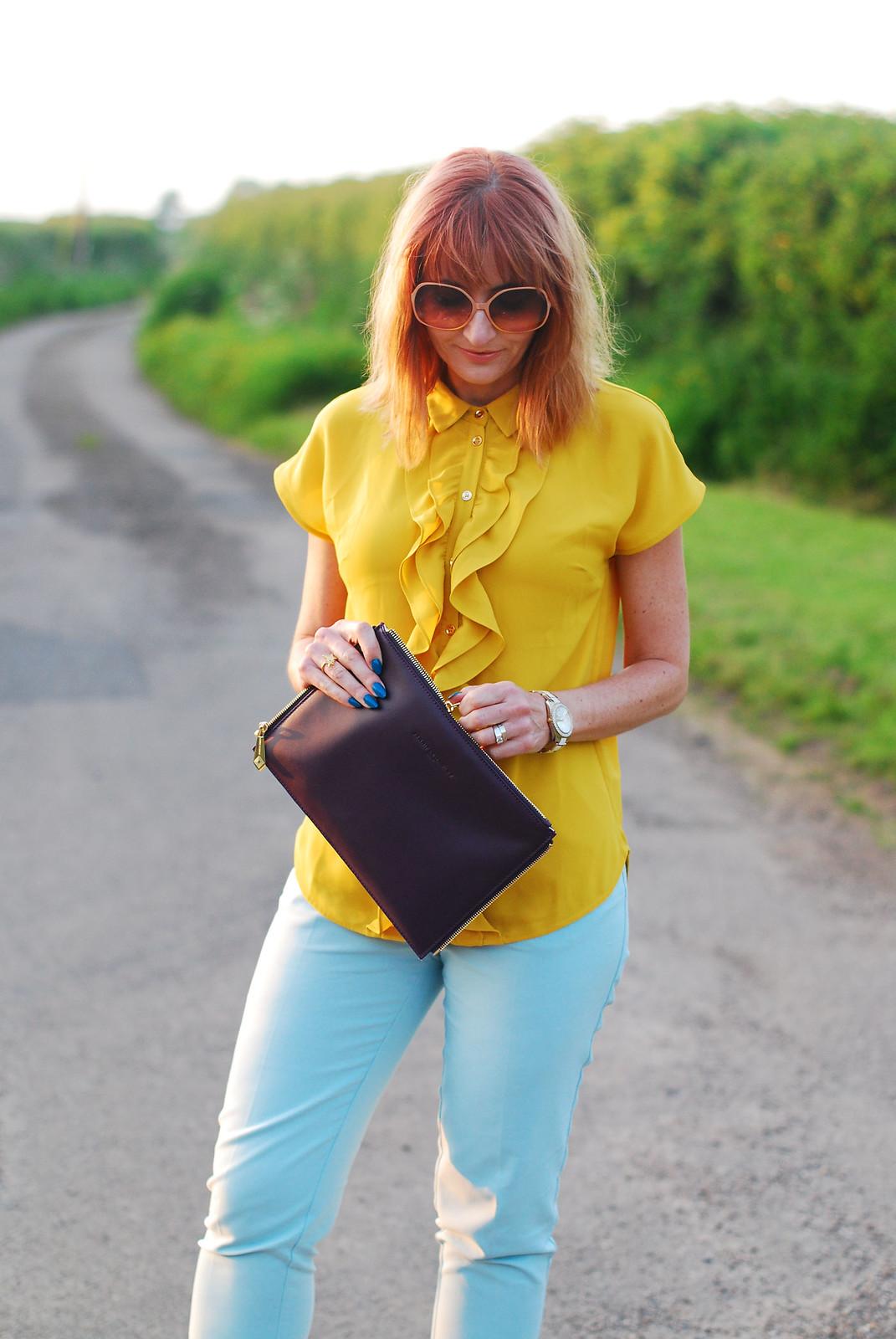 Summer brights: Ruffled yellow blouse, mint trousers, Jennifer Hamley Model KT Workbag clutch, oversized 70s sunglasses | Not Dressed As Lamb