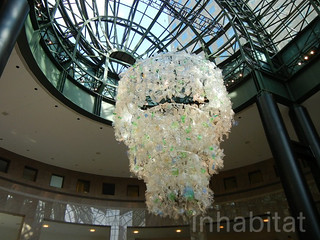"Katharine Harvey's Glittering Plastic ""Chandelier"" is Made from 1,000s of Pieces of Garbage 