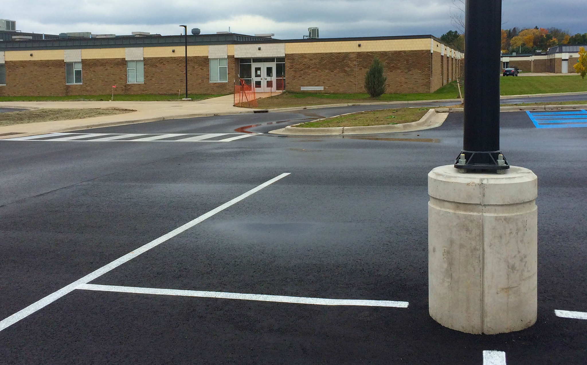 Precast light pole bases for high school parking lot renovation