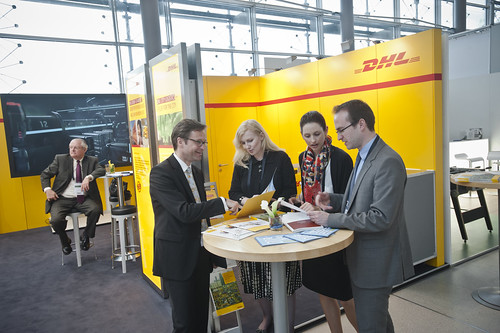 Exhibition Stand Transport : Delegates study information leaflets at the dhl exhibition