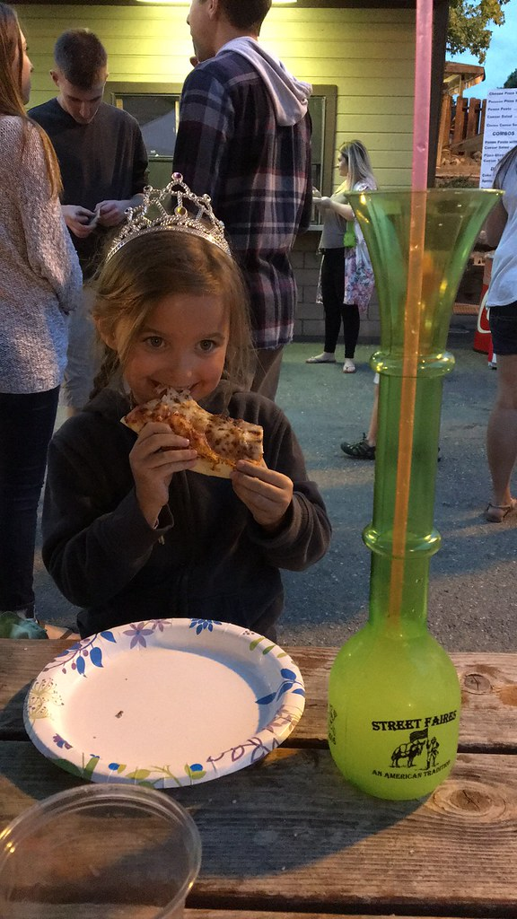 Renee having pizza and lemonade at the fair