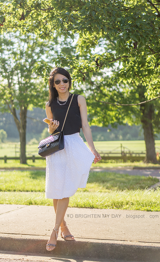 black silk sleeveless top, white midi skirt, black crossbody bag, suede and jeweled sandals