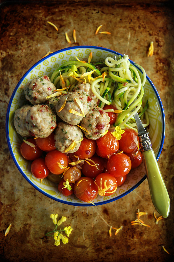 Zoodles with blistered tomatoes and mini sundried tomato chicken meatballs- paleo from HeatherChristo.com