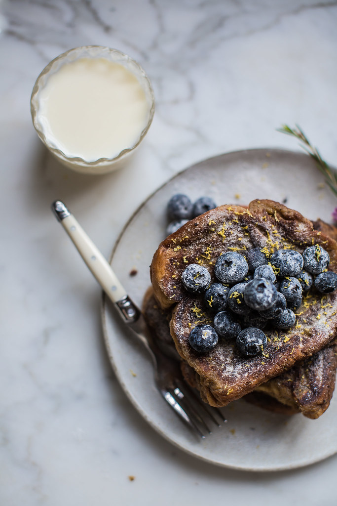 Food styling photography with Brioche French Toast with sugared blueberries and lemon zest