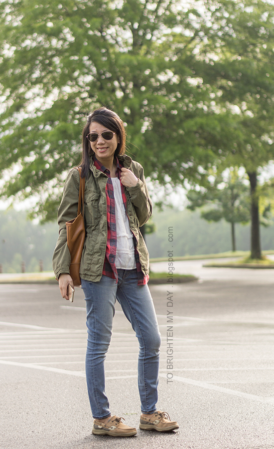 green military jacket, plaid shirt, fringe and lace top, lightwash jeans, cognac brown tote, boat shoes