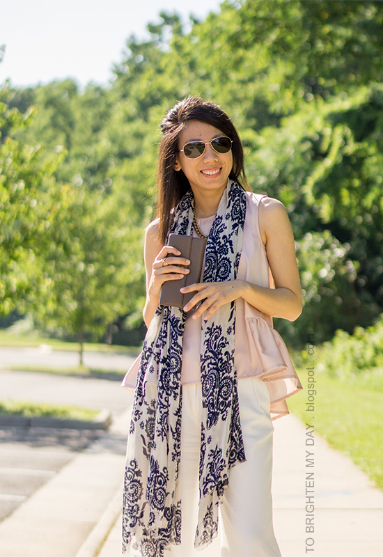 blue floral scarf, gold jewelry, pink peplum top, taupe clutch, white wide-legged trousers