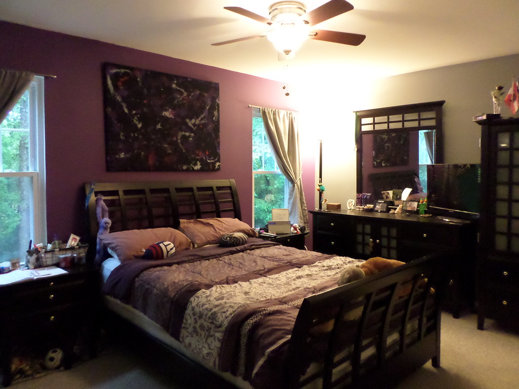 Purple and grey decor in master bedroom