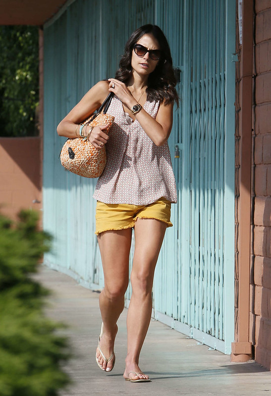 mustard-yellow-shorts-flat-sandals-shortsleeved-top-black-sunglasses-woven-straw-handbag