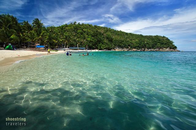 Puting Buhangin Beach viewed from the entrance to Kwebang Lampas