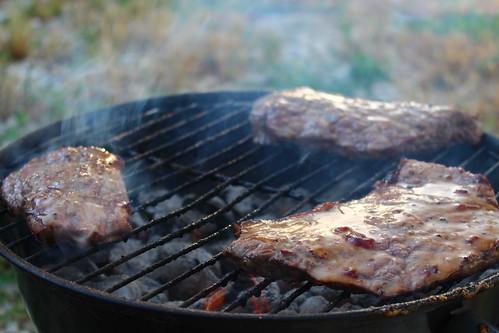 Grilling steaks.