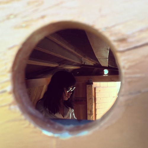 Ana through peephole in Kiddie Clubhouse at Cullipher Farm Market (May 25 2015)